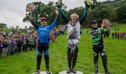 Second place Ruaridh Cunningham, first place Bernard Kerr and third place Adam Brayton celebrate on the podium of Red Bull Hard Line in Dinas Mawddwy, UK, on September 18, 2016